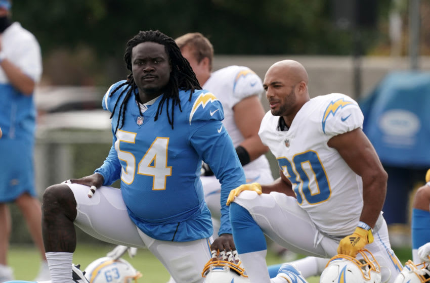 Aug 30, 2020; Los Angeles, California, United States; Los Angeles Chargers defensive end Melvin Ingram III (54) and running back Austin Ekeler (30) stretch during training camp at the Jack Hammett Sports Complex. Mandatory Credit: Kirby Lee-USA TODAY Sports