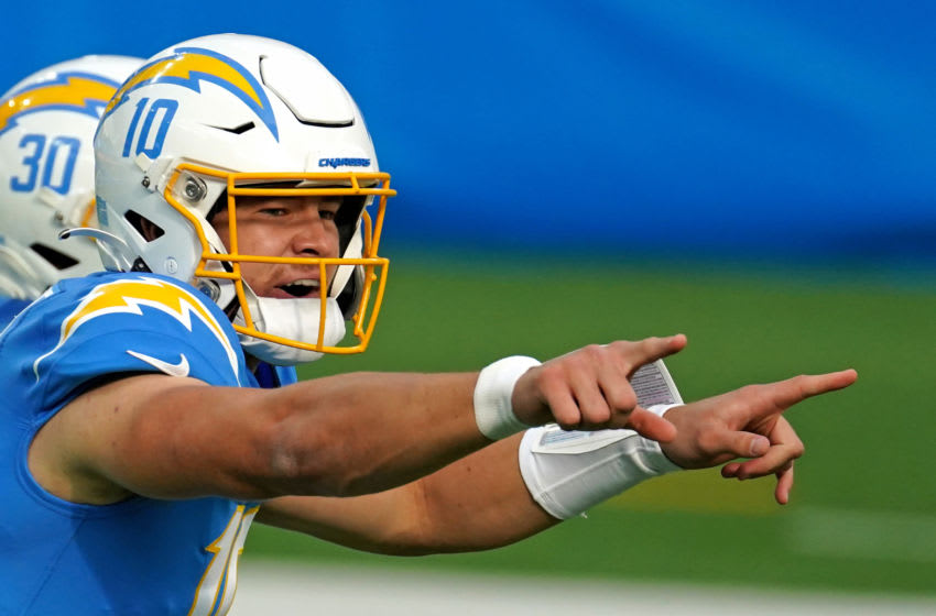 Dec 27, 2020; Inglewood, California, USA; Los Angeles Chargers quarterback Justin Herbert (10) gestures at the line of scrimmage during the first half against the Denver Broncos at SoFi Stadium. Mandatory Credit: Kirby Lee-USA TODAY Sports