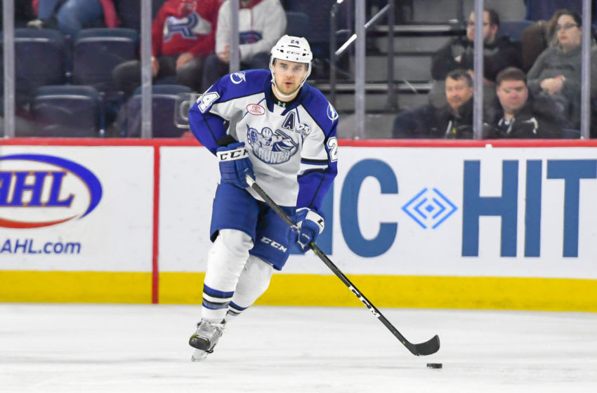 LAVAL, QC, CANADA - MARCH 13: Cameron Gaunce #24 of the Syracuse Crunch skating up the ice in control of the puck against the Laval Rocket at Place Bell on March 13, 2019 in Laval, Quebec. (Photo by Stephane Dube /Getty Images)