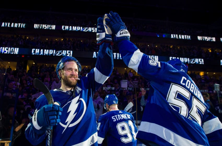 TAMPA, FL - MARCH 18: Victor Hedman #77 of the Tampa Bay Lightning celebrates with Braydon Coburn #55 after defeating the Arizona Coyotes 4-1 to win the Atlantic Division and the President's Trophy at Amalie Arena on March 18, 2019 in Tampa, Florida. (Photo by Scott Audette/NHLI via Getty Images)