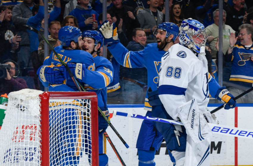 ST. LOUIS, MO - MARCH 23: Vladimir Tarasenko #91 of the St. Louis Blues is congratulated after scoring a goal against the Tampa Bay Lightning at Enterprise Center on March 23, 2019 in St. Louis, Missouri. (Photo by Scott Rovak/NHLI via Getty Images)