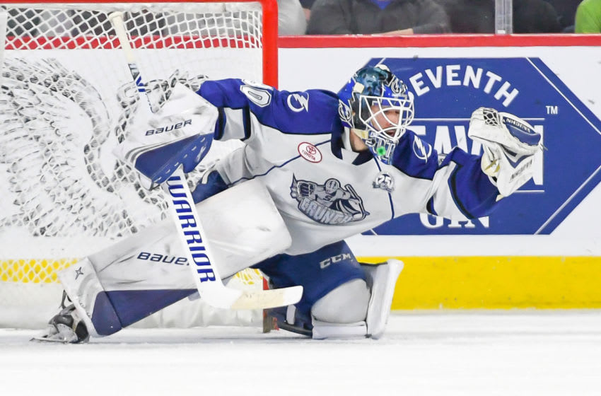 LAVAL, QC, CANADA - MARCH 13: Eddie Pasquale of the Syracuse Crunch makes save during a match against the Laval Rocket at Place Bell on March 13, 2019 in Laval, Quebec. (Photo by Stephane Dube/Getty Images)