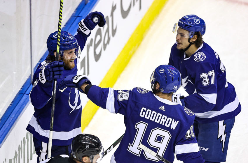 TORONTO, ONTARIO - AUGUST 25: Blake Coleman #20 of the Tampa Bay Lightning is congratulated by his teammates, Barclay Goodrow #19 and Yanni Gourde #37, after scoring a goal against the Boston Bruins during the third period in Game Two of the Eastern Conference Second Round during the 2020 NHL Stanley Cup Playoffs at Scotiabank Arena on August 25, 2020 in Toronto, Ontario. (Photo by Elsa/Getty Images)