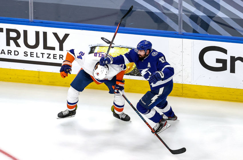 EDMONTON, ALBERTA - SEPTEMBER 07: Scott Mayfield #24 of the New York Islanders is checked by Alex Killorn #17 of the Tampa Bay Lightning during the third period in Game One of the Eastern Conference Final during the 2020 NHL Stanley Cup Playoffs at Rogers Place on September 07, 2020 in Edmonton, Alberta, Canada. (Photo by Bruce Bennett/Getty Images)