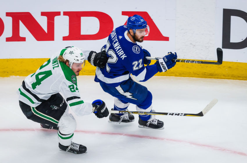 Sep 21, 2020; Edmonton, Alberta, CAN; Tampa Bay Lightning defenseman Kevin Shattenkirk (22) and Dallas Stars left wing Roope Hintz (24) during the first period in game two of the 2020 Stanley Cup Final at Rogers Place. Mandatory Credit: Sergei Belski-USA TODAY Sports