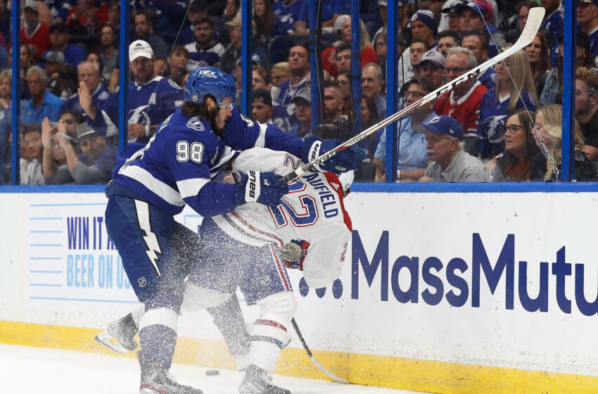 Jul 7, 2021; Tampa, Florida, USA; Tampa Bay Lightning defenseman Mikhail Sergachev (98) checks Montreal Canadiens right wing Cole Caufield (22) during the first period in game five of the 2021 Stanley Cup Final at Amalie Arena. Mandatory Credit: Kim Klement-USA TODAY Sports