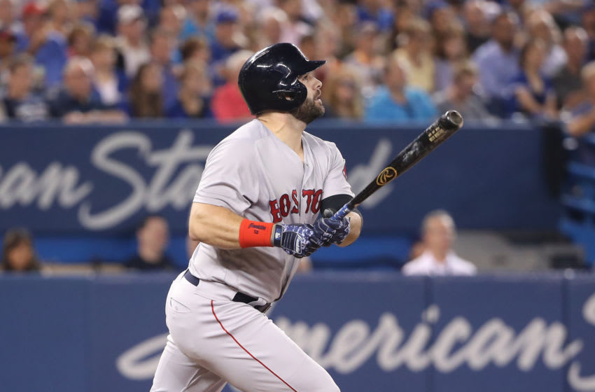 TORONTO, ON - AUGUST 8: Mitch Moreland #18 of the Boston Red Sox hits a two-run double in the third inning during MLB game action against the Toronto Blue Jays at Rogers Centre on August 8, 2018 in Toronto, Canada. (Photo by Tom Szczerbowski/Getty Images)