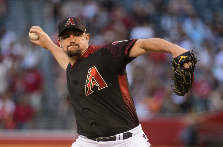 PHOENIX, ARIZONA - JUNE 22: Zack Godley #52 of the Arizona Diamondbacks delivers a pitch during the first inning of the MLB game against the San Francisco Giants at Chase Field on June 22, 2019 in Phoenix, Arizona. (Photo by Jennifer Stewart/Getty Images)
