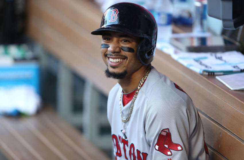 ANAHEIM, CALIFORNIA - AUGUST 31: Mookie Betts #50 of the Boston Red Sox looks on from the dugout prior to a game against the Los Angeles Angels of Anaheim at Angel Stadium of Anaheim on August 31, 2019 in Anaheim, California. (Photo by Sean M. Haffey/Getty Images)