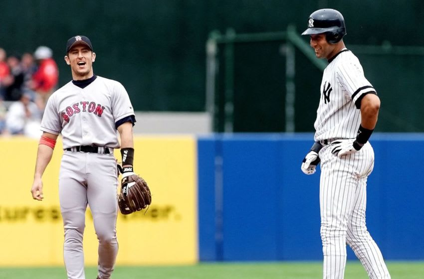 Boston Red Sox shortstop Nomar Garciaparra (L) jokes with New York Yankees shortstop Derek Jeter (R) 27 May, 2000 at Yankee Stadium in New York. The two all-star shortstops each returned to their teams' line-ups in the game after stints on the disbled list. (ELECTRONIC IMAGE) AFP PHOTO/Matt CAMPBELL (Photo by MATT CAMPBELL / AFP) (Photo by MATT CAMPBELL/AFP via Getty Images)
