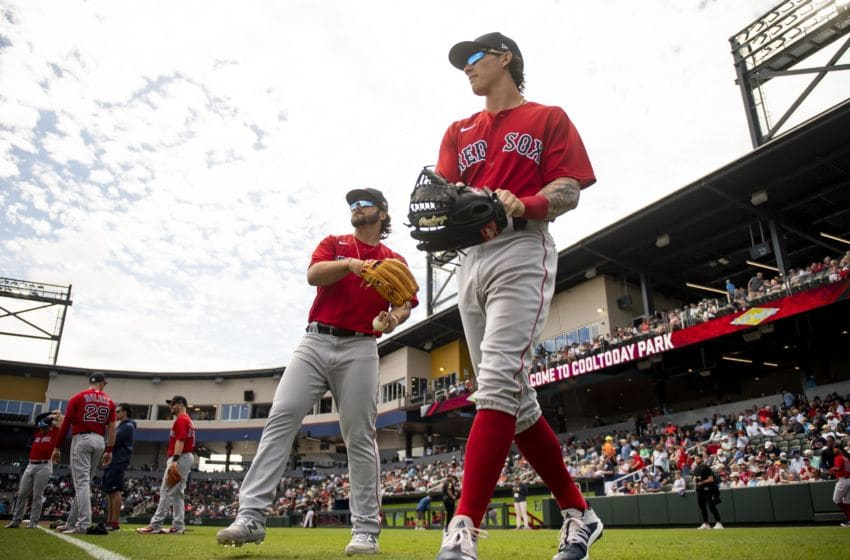 NORTH PORT, FL - MARCH 6: Nick Longhi #83 and Jarren Duran #92 of the Boston Red Sox warm up before a Grapefruit League game against the Atlanta Braves on March 6, 2020 at CoolToday Park in North Port, Florida. (Photo by Billie Weiss/Boston Red Sox/Getty Images)