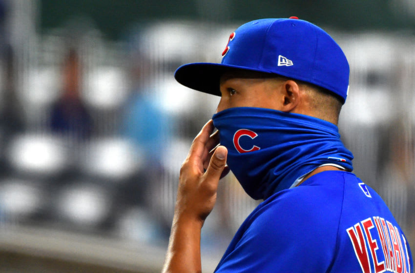 KANSAS CITY, MISSOURI - AUGUST 05: Third base coach Will Venable adjust his mask as the watches in the fifth inning against the Kansas City Royals at Kauffman Stadium on August 05, 2020 in Kansas City, Missouri. (Photo by Ed Zurga/Getty Images)