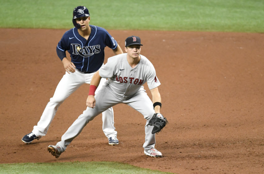 ST PETERSBURG, FLORIDA - SEPTEMBER 11: Nate Lowe #35 of the Tampa Bay Rays leads off first base as Bobby Dalbec #29 of the Boston Red Sox defends during the third inning at Tropicana Field on September 11, 2020 in St Petersburg, Florida. (Photo by Douglas P. DeFelice/Getty Images)