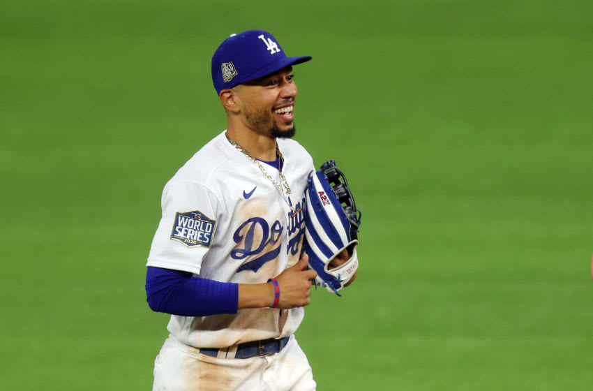 ARLINGTON, TEXAS - OCTOBER 20: Mookie Betts #50 of the Los Angeles Dodgers celebrates the teams 8-3 victory against the Tampa Bay Rays in Game One of the 2020 MLB World Series at Globe Life Field on October 20, 2020 in Arlington, Texas. (Photo by Ronald Martinez/Getty Images)