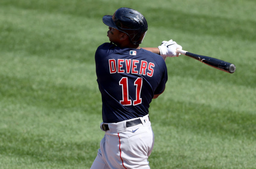 BALTIMORE, MARYLAND - APRIL 08: Rafael Devers #11 of the Boston Red Sox follows his two RBI home run against the Baltimore Orioles in the first inning during the Orioles home opener at Oriole Park at Camden Yards on April 08, 2021 in Baltimore, Maryland. (Photo by Rob Carr/Getty Images)