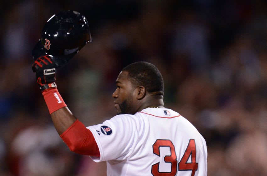BOSTON, MA - SEPTEMBER 4: David Ortiz #34 of the Boston Red Sox acknowledges the crowd after hitting his 2000th career hit, a double against the Detroit Tigers during the sixth inning on September 4, 2013 at Fenway Park in Boston Massachusetts. (Photo by Michael Ivins/Boston Red Sox/Getty Images)