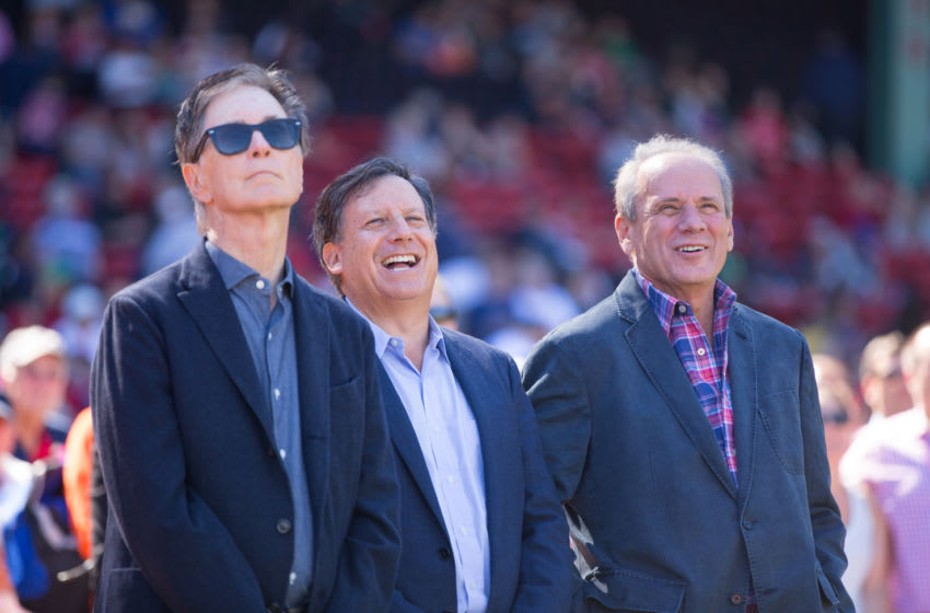 BOSTON, MA - SEPTEMBER 27: John Henry, Tom Werner and Larry Lucchino share a laugh as Lucchino was being honored for his last home game as Red Sox CEO/President before a game against the Baltimore Orioles Fenway Park on September 27, 2015 in Boston, Massachusetts. (Photo by Rich Gagnon/Getty Images)