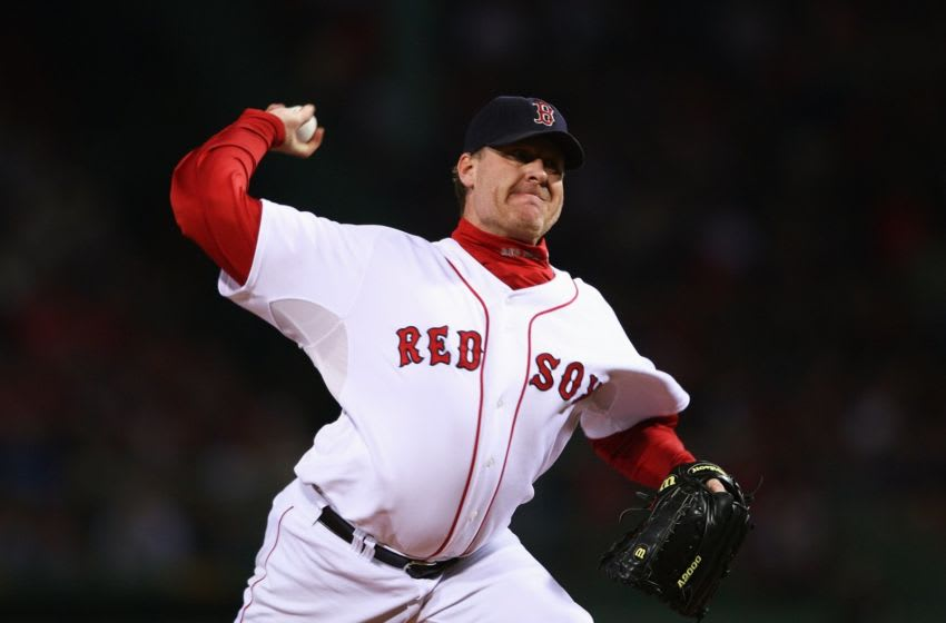 BOSTON - OCTOBER 13: Starting pitcher Curt Schilling #38 of the Boston Red Sox pitches in the first inning of Game Two of the American League Championship Series against the Cleveland Indians at Fenway Park on October 13, 2007 in Boston, Massachusetts. (Photo by Elsa/Getty Images)