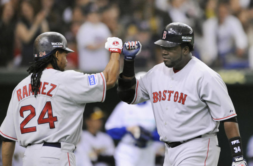 Boston Red Sox David Ortiz (R) is congratulated his solo homer by teammate Manny Ramirez in the top of the first innings against Japan's Hanshin Tigers in an exhibition game in the Tokyo Dome on March 22, 2008.The Boston Red Sox managed a narrow 6-5 victory against Tigers in an exhibition game here, days ahead of the official season opening games against the Oakland Athletics. AFP PHOTO / KAZUHIRO NOGI (Photo credit should read KAZUHIRO NOGI/AFP via Getty Images)