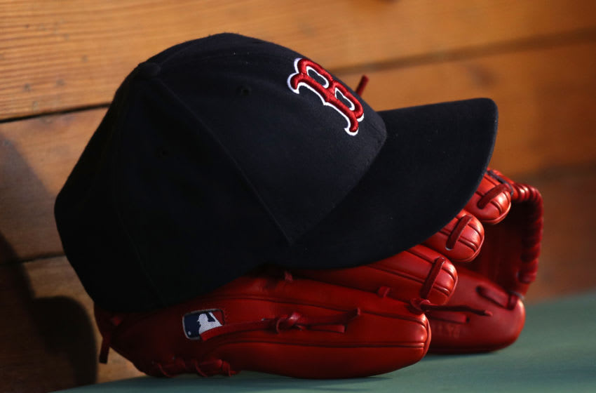 BOSTON, MA - June 6: A hat and glove sit in the Boston Red Sox dugout during the third inning of the game against the Detroit Tigers at Fenway Park on June 6, 2018 in Boston, Massachusetts. (Photo by Maddie Meyer/Getty Images)