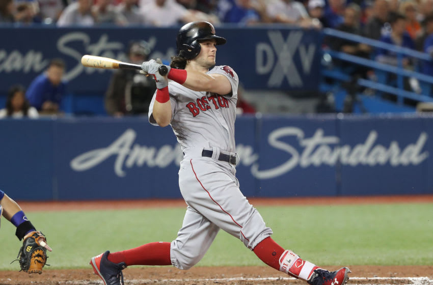 TORONTO, ON - AUGUST 29: Andrew Benintendi #16 of the Boston Red Sox hits a soft infield single in the sixth inning during MLB game action against the Toronto Blue Jays at Rogers Centre on August 29, 2017 in Toronto, Canada. (Photo by Tom Szczerbowski/Getty Images)