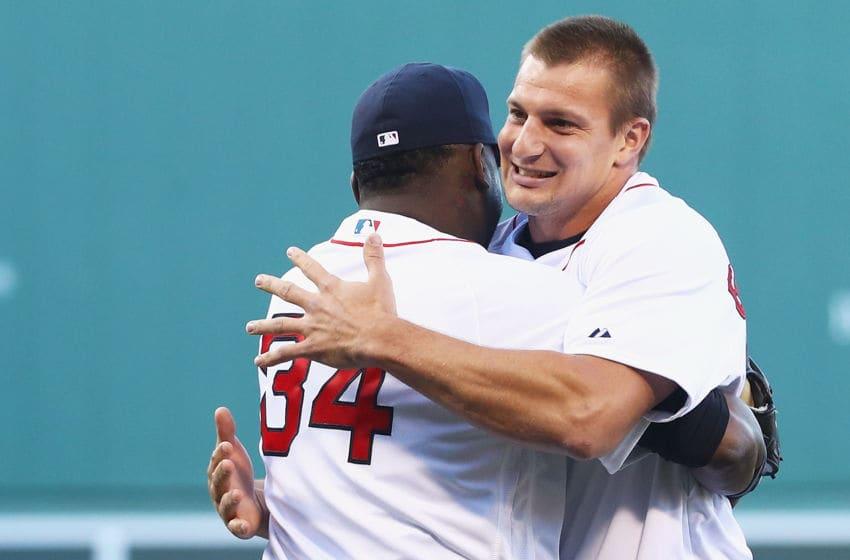BOSTON, MA - JULY 19: Rob Gronkowski of the New England Patriots hugs David Ortiz