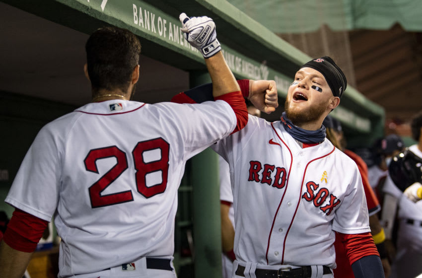 BOSTON, MA - SEPTEMBER 5: J.D. Martinez #28 of the Boston Red Sox high fives Alex Verdugo #99 after hitting a solo home run during the second inning of a game against the Toronto Blue Jays on September 5, 2020 at Fenway Park in Boston, Massachusetts. The 2020 season had been postponed since March due to the COVID-19 pandemic. (Photo by Billie Weiss/Boston Red Sox/Getty Images)