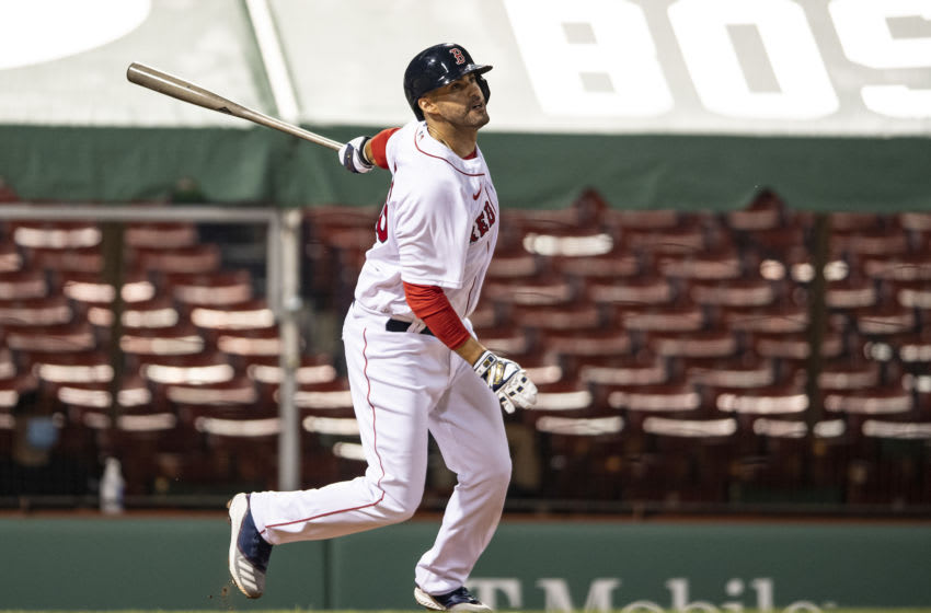 BOSTON, MA - JULY 24: J.D. Martinez #28 of the Boston Red Sox hits a double during the Opening Day game against the Baltimore Orioles on July 24, 2020 at Fenway Park in Boston, Massachusetts. The 2020 season had been postponed since March due to the COVID-19 pandemic. (Photo by Billie Weiss/Boston Red Sox/Getty Images)