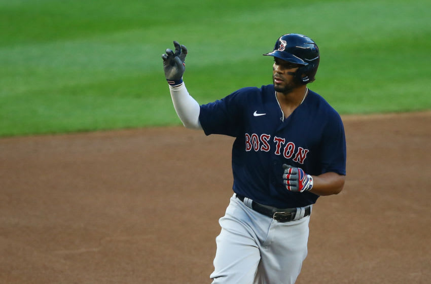 Xander Bogaerts of the Boston Red Sox celebrates after hitting a 2-run home run. (Photo by Mike Stobe/Getty Images)