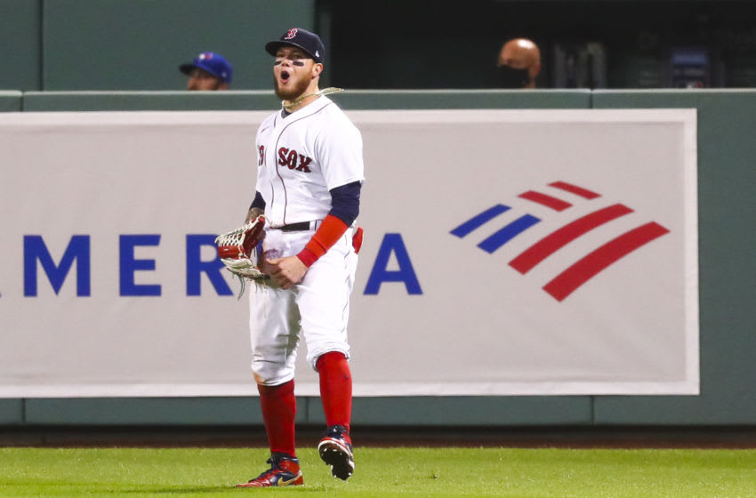 BOSTON, MA - AUGUST 07: Alex Verdugo #99 of the Boston Red Sox reacts after robbing a home run in the ninth inning of a game against the Toronto Blue Jays at Fenway Park on August 7, 2020 in Boston, Massachusetts. (Photo by Adam Glanzman/Getty Images)