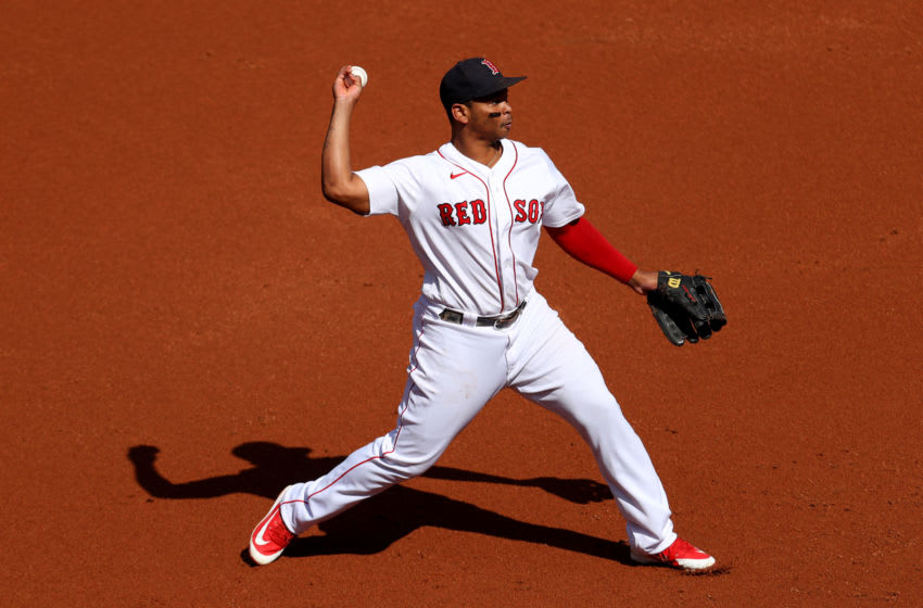 BOSTON, MASSACHUSETTS - SEPTEMBER 20: Rafael Devers #11 of the Boston Red Sox throws to first during the third inning against the New York Yankees at Fenway Park on September 20, 2020 in Boston, Massachusetts. (Photo by Maddie Meyer/Getty Images)