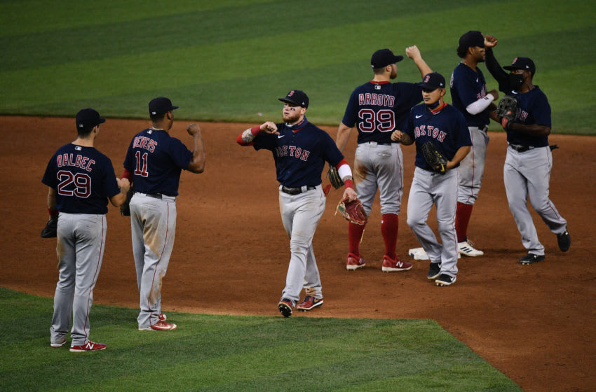 MIAMI, FLORIDA - SEPTEMBER 17: (L-R) Bobby Dalbec #29, Rafael Devers #11, Alex Verdugo #99. Tzu-Wei Lin #30, Jackie Bradley Jr. #19, Christian Arroyo #39 and Xander Bogaerts #2 of the Boston Red Sox celebrate after winning against the Miami Marlins by score of 5-3 at Marlins Park on September 17, 2020 in Miami, Florida. (Photo by Mark Brown/Getty Images)