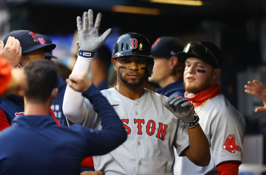 NEW YORK, NEW YORK - APRIL 28: Xander Bogaerts #2 of the Boston Red Sox celebrates after scoring on Christian Vazquez #7 RBI double in the second inning against the New York Mets at Citi Field on April 28, 2021 in New York City. (Photo by Mike Stobe/Getty Images)