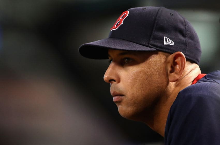 PHOENIX, ARIZONA - APRIL 05: Manager Alex Cora #20 of the Boston Red Sox watches from the dugout during the fifth inning of the MLB game against the Arizona Diamondbacks at Chase Field on April 05, 2019 in Phoenix, Arizona. (Photo by Christian Petersen/Getty Images)