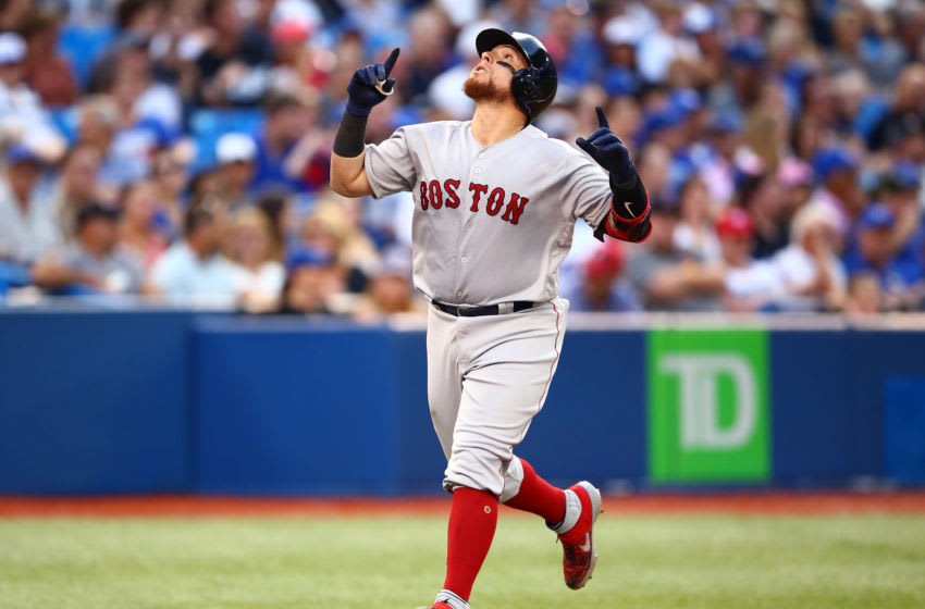 TORONTO, ON - JULY 03: Christian Vazquez #7 of the Boston Red Sox hits a home run in the fourth inning during a MLB game against the Toronto Blue Jays at Rogers Centre on July 03, 2019 in Toronto, Canada. (Photo by Vaughn Ridley/Getty Images)