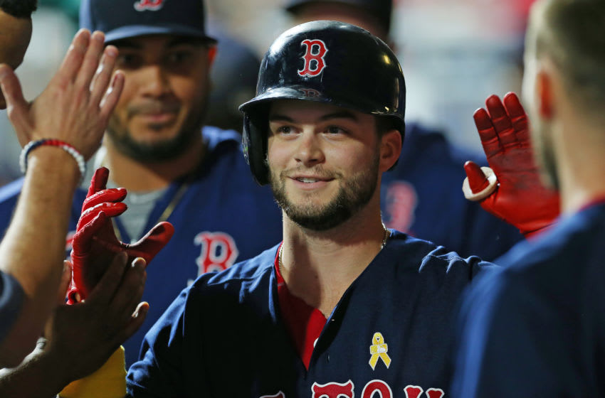 PHILADELPHIA, PA - SEPTEMBER 14: Andrew Benintendi #16 of the Boston Red Sox is congratulated after knocking in a run on a sacrifice fly against the Philadelphia Phillies during the ninth inning of a game at Citizens Bank Park on September 14, 2019 in Philadelphia, Pennsylvania. The Red Sox defeated the Phillies 2-1.(Photo by Rich Schultz/Getty Images)