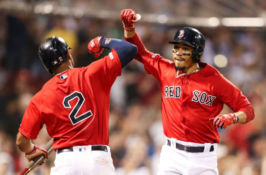 BOSTON, MA - AUGUST 16: Mookie Betts #50 of the Boston Red Sox high fives Xander Bogaerts #2 of the Boston Red Sox after hitting a solo home run in the eighth inning of a game against the Baltimore Orioles at Fenway Park on August 16, 2019 in Boston, Massachusetts. (Photo by Adam Glanzman/Getty Images)
