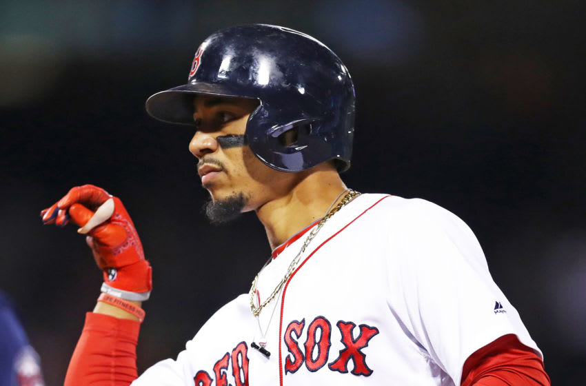 BOSTON, MASSACHUSETTS - SEPTEMBER 04: Mookie Betts #50 of the Boston Red Sox celebrates after hitting a single during the sixth inning against the Minnesota Twins at Fenway Park on September 04, 2019 in Boston, Massachusetts. (Photo by Maddie Meyer/Getty Images)