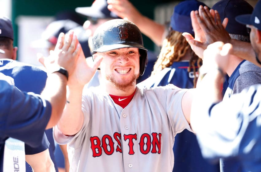 CINCINNATI, OH - SEPTEMBER 24: Christian Vazquez #7 of the Boston Red Sox is congratulated after being driven in by a three-run double hit by Mookie Betts #50 of the Boston Red Sox in the eighth inning of the game against the Cincinnati Reds at Great American Ball Park on September 24, 2017 in Cincinnati, Ohio. Boston defeated Cincinnati 5-4. (Photo by Kirk Irwin/Getty Images)