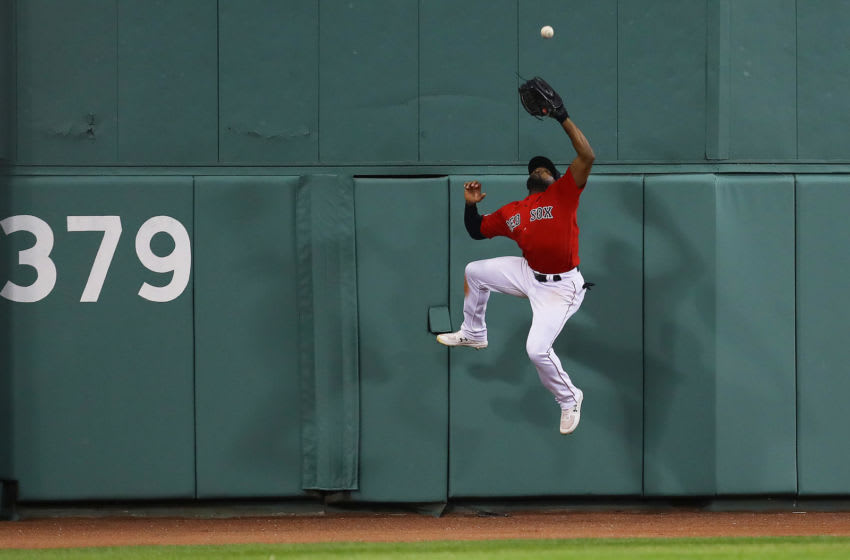 BOSTON, MASSACHUSETTS - SEPTEMBER 09: Jackie Bradley Jr. #19 of the Boston Red Sox catches a fly ball hit by Edwin Encarnacion #30 of the New York Yankees during the seventh inning of the game between the Boston Red Sox and the New York Yankees at Fenway Park on September 09, 2019 in Boston, Massachusetts. (Photo by Maddie Meyer/Getty Images)