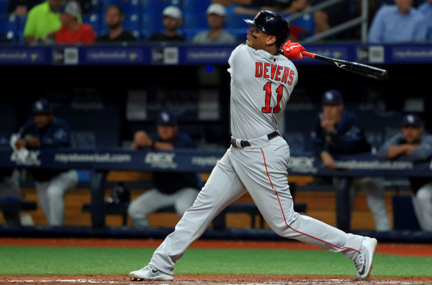 ST PETERSBURG, FLORIDA - SEPTEMBER 23: Rafael Devers #11 of the Boston Red Sox hits an RBI single in the fourth inning during a game against the Tampa Bay Rays at Tropicana Field on September 23, 2019 in St Petersburg, Florida. (Photo by Mike Ehrmann/Getty Images)