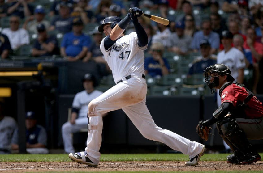 MILWAUKEE, WI - MAY 23: Jett Bandy #47 of the Milwaukee Brewers hits a single in the fourth inning against the Arizona Diamondbacks at Miller Park on May 23, 2018 in Milwaukee, Wisconsin. (Photo by Dylan Buell/Getty Images)