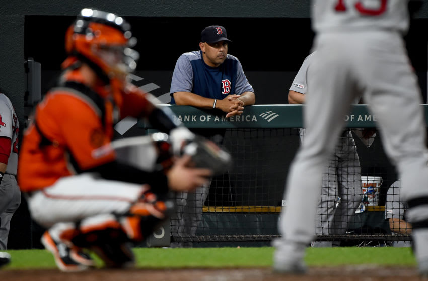 BALTIMORE, MD - JULY 20: Manager Alex Cora #20 of the Boston Red Sox looks on during the game against the Baltimore Orioles at Oriole Park at Camden Yards on July 20, 2019 in Baltimore, Maryland. (Photo by Will Newton/Getty Images)