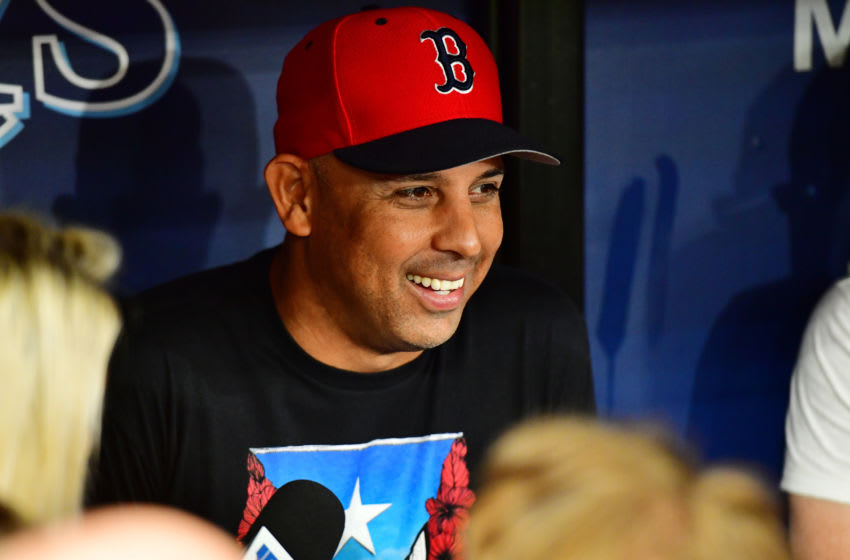 ST. PETERSBURG, FLORIDA - JULY 22: Manager Alex Cora #20 of the Boston Red Sox answers questions from reporters prior to a baseball game against the Tampa Bay Rays at Tropicana Field on July 22, 2019 in St. Petersburg, Florida. (Photo by Julio Aguilar/Getty Images)