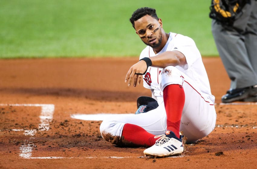 BOSTON, MA - AUGUST 05: Xander Bogaerts #2 of the Boston Red Sox reacts after he is tagged out at home plate by Meibrys Viloria #72 of the Kansas City Royals in the first inning of a game at Fenway Park on August 5, 2019 in Boston, Massachusetts. (Photo by Adam Glanzman/Getty Images)