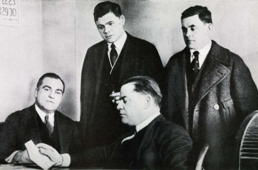BOSTON - 1918: The top officials of the Boston Red Sox, Ed Barrow, left, and Harry Frazee, seated center, talk with Babe Ruth, center top, and Stuffy McInnis about the upcoming baseball season in 1918. (Photo by Mark Rucker/Transcendental Graphics/Getty Images)