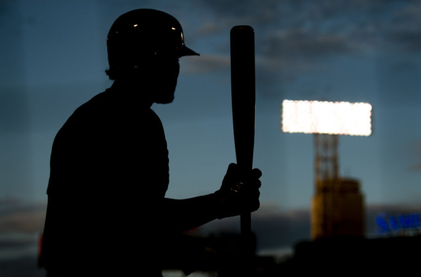BOSTON, MA - JULY 17: Xander Bogaerts #2 of the Boston Red Sox warms up on deck during an intrasquad game during a summer camp workout before the start of the 2020 Major League Baseball season on July 17, 2020 at Fenway Park in Boston, Massachusetts. The season was delayed due to the coronavirus pandemic. (Photo by Billie Weiss/Boston Red Sox/Getty Images)