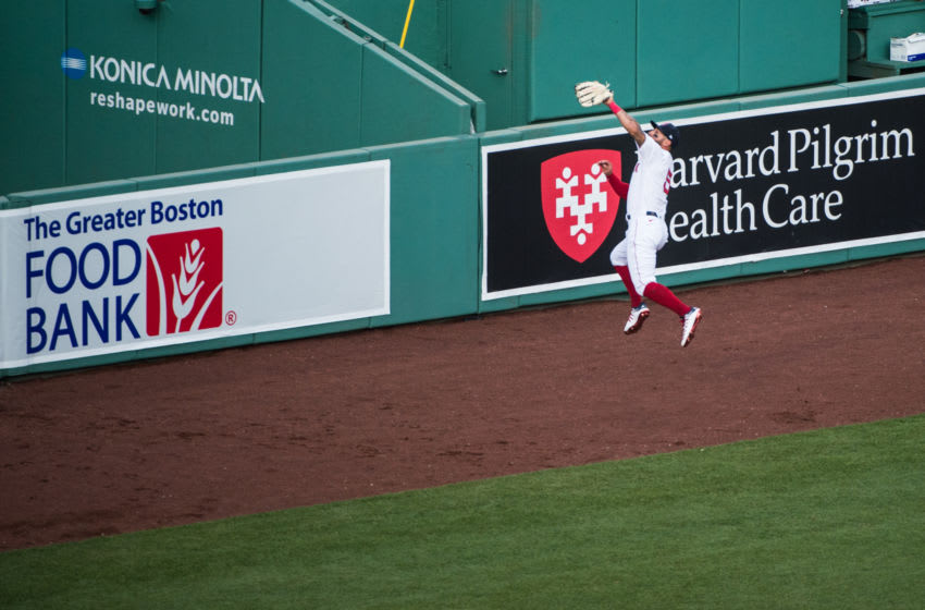 BOSTON, MA - JULY 24: Kevin Pillar #5 of the Boston Red Sox makes a leaping catch in the first inning against the Baltimore Orioles on Opening Day at Fenway Park on July 24, 2020 in Boston, Massachusetts. The 2020 season had been postponed since March due to the COVID-19 pandemic. (Photo by Kathryn Riley/Getty Images)
