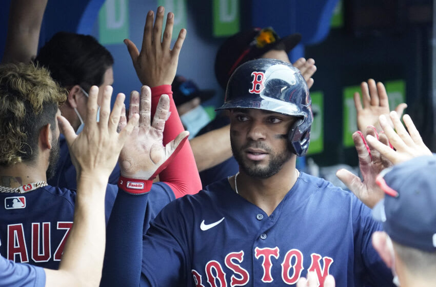 Aug 8, 2021; Toronto, Ontario, CAN; Boston Red Sox shortstop Xander Bogaerts (2) is congratulated after scoring in the fourth inning against the Toronto Blue Jays at Rogers Centre. Mandatory Credit: John E. Sokolowski-USA TODAY Sports