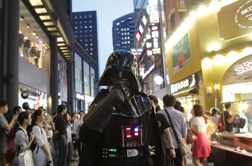 SEOUL, SOUTH KOREA - SEPTEMBER 04: A South Korean man dressed in a Darth Vader during the 'Star Wars - Force Friday' in Myeongdong shopping district on September 4, 2015 in Seoul, South Korea. Darth Vader and Stormtroopers made appearance at the global launch event 'Star Wars - Force Friday' that Disney planned to debut the toys inspired by the upcoming film, 'Star Wars: The Force Awakens.' (Photo by Chung Sung-Jun/Getty Images)